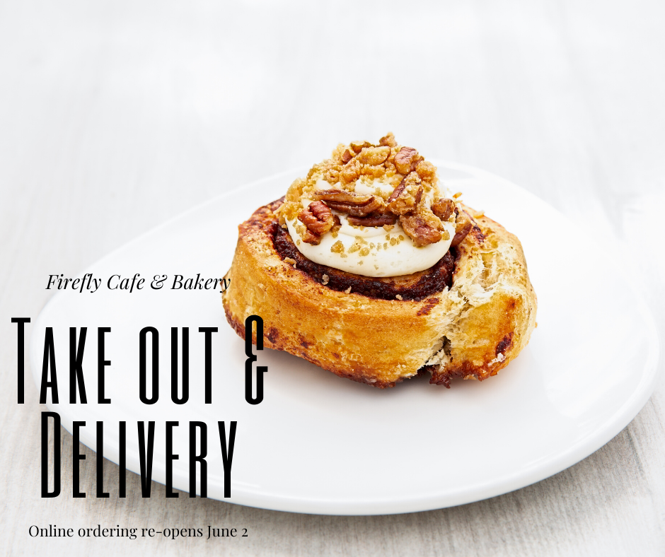 "Image of a cinnamon roll on a white plate. Black text reads ""Firefly cafe and bakery. Take out and delivery. Online ordering reopens June 2nd."""